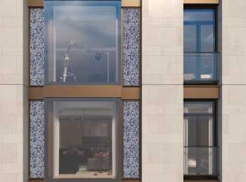 Фасады выполнены с применением сине-голубых мозаичных панно, натурального камня и бронзовых деталей